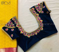 Stunning deep blue color designer blouse with floret lata design hand embroidery thread work on neckline and back of blouse. Cutwork Blouse Designs, Kids Blouse Designs, Wedding Saree Blouse Designs, Pattu Saree Blouse Designs, Embroidery Neck Designs, Simple Blouse Designs, Stylish Blouse Design, Blouse Neck Designs, Hand Embroidery