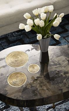 The Jonathan Adler Trocadero Kidney Table is lacquered inky charcoal goatskin and adorned with three, inset sand-cast brass medallions. Give your living room global glamour.