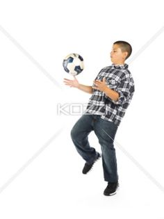 soccer playing boy - A teen boy playing soccer
