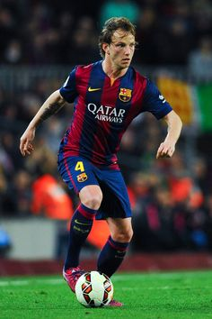 Ivan Rakitic of FC Barcelona runs with the ball during the La Liga match Between FC Barcelona and Real Madrid CF at Camp Nou on March 22, 2015 in Barcelona, Catalonia.
