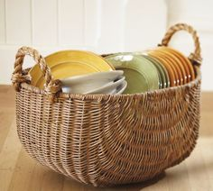 I'm digging this basket- keeping the living room more organized :)