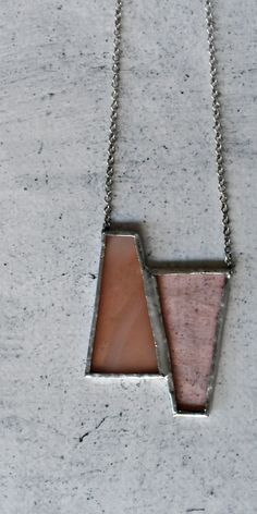 Romantic and minimal necklace in powder pink stained glass, handmade in Italy with sterling silver chain.