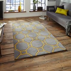 The contemporary Geometric design in Grey and Yellow is sure to be a focal point in any room of your home. #TheRugSeller #YellowRugs
