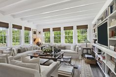 Grey living room in an East Hampton compound with stained wood floor, built in bookcase and painted ceiling beams Living Room Grey, Home Living Room, Living Spaces, Style At Home, Family Room Addition, Room Additions, Family Room Design, Family Rooms, Family Den