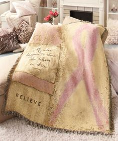 "50"" x 60"" Pink Ribbon Throw   features a stirring sentiment in support of the battle to end breast cancer."