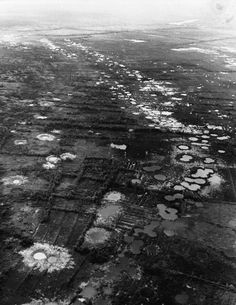 Water-filled bomb craters from B-52 strikes against the Viet Cong mark the rice paddies and orchards west of Saigon, Vietnam, 1966. Most of the area had been abandoned by the peasants who used to farm on the land.