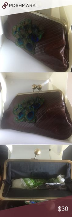 Handmade Brown Leather & Peacock Clutch Gift ✅Handmade by me ✅Features a bronze kiss lock clutch with peacock feather ornament. 🌺Dimensions : L 11.5 x W 7.4. It can contain a phone as big as an IPhone 6s Plus , your keys , wallet, card holder, lipstick, powder and other small things🙌 🌷only 1 available of this on this earth🌷 Nikara Bags Clutches & Wristlets