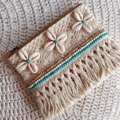 Handmade hand embellished fully line leather coin purse trimmed with cowries and beads Plain leather other side