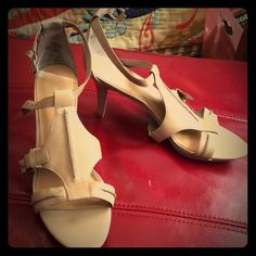 Adorable and comfortable Nine West sandals Work and party appropriate, perfect beige toned patent leather sandals. Cool wrap around styling on the upper. Never worn, perfect condition. These will be your go-to shoes. Nine West Shoes Sandals