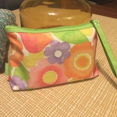 Clinique Spring Flowers Pouch Used many times, inside of pouch has some marks, wear can be seen in pics) I LOVE  using these cute pouches to help keep the inside of my hand bags clean and organized, great size pouch Clinique Bags Cosmetic Bags & Cases