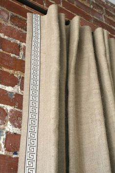 linen, drop cloth or burlap drapes with greek key trim detail. local quilt shop can sew allover [same-color as fabric] pattern on dropcloth for elegant custom look that is subtle yet complements trim tape on panel sides.