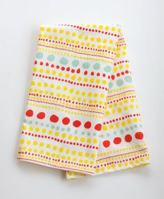 This whimsical multicolored tea towel is perfect for your kitchen, bathroom, for gifting a bottle of wine, or even framing! Hemmed on four sides with a loop for hanging. The cotton grown to create the towel is certified fair trade and the weavers also receive a living wage for their work.