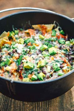 Nachos Campfire Nachos made in a Dutch oven are a simple, fast, and easy camping meal that the whole family will enjoy.Campfire Nachos made in a Dutch oven are a simple, fast, and easy camping meal that the whole family will enjoy. Vegetarian Nachos, Veggie Nachos, Vegetarian Camping Recipes, Dutch Oven Camping, Campfire Dutch Oven Recipes, Snack Recipes, Cooking Recipes, Dinner Recipes, Easy Recipes
