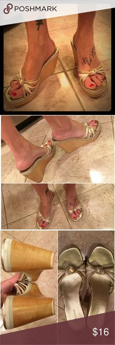 BCBGirls 💛 Metallic Leather & Wood Wedges Brazil Size 9.5, but seem to run a bit small (I wear an 8.5 or 9 depending on the shoe, and I'm modeling them). BCBGirls shoes: the upper is knotted leather straps in white, beige and soft gold. Wooden platform/wedge. Great used condition with minor signs of wear. BCBGirls Shoes Wedges