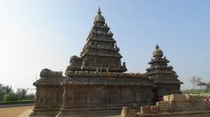 The Shore Temple was constructed in the early eighth century during a time when Mamallapuram was the port city for the areas controlled by the Pallava dynasty who had their capital at Kanchipuram, but the small Bhuvaraha shrine, which was not discovered until 1960, dates from the mid-seventh century. The rows of Nandis, now worn to form rather than detail, make it obvious that this was a Shiva temple.