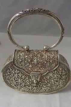 Vintage sterling floral repousse evening bag.