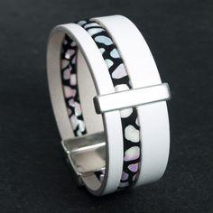 Bracelet cuir blanc daim noir à motifs nuancés 39€