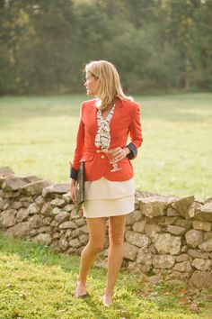 Red Blazer paired with cream tones