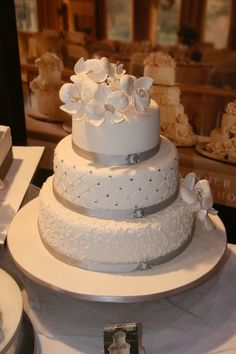 simple and elegant cake....love. coral ribbon and peonies