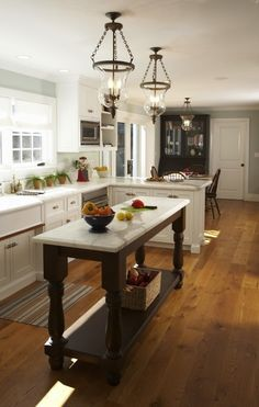 Suzie: Mahoney Architects & Interiors - Beautiful kitchen with smoky blue walls paint color, ...narrow island