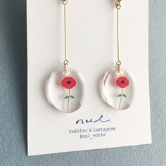 A Crystal resin oval with a vivid red flower shining out hangs from a delicate chain to form these earrings. Pleasing to look at and handmade they are sure to please. Diy Resin Crafts, Diy And Crafts, Cute Jewelry, Jewelry Crafts, Handmade Accessories, Handmade Jewelry, Resin Jewelry Making, Diy Earrings, Resin Art