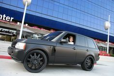 Tommy Hilfiger's son Rich in his flat black Ranger Rover <3