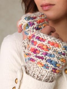 Hey, it's the ballband dishcloth, knit up with funky yarn in mitten form!