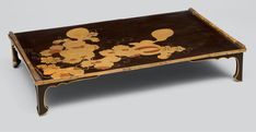 Writing table (bundai, 文台) with melons and squirrels Momoyama–Edo period, early 17th century Black lacquer with gold maki-e and pictorial pearskin ground (e-nashiji, 絵梨地)