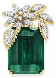 "A TOURMALINE AND DIAMOND ""FOUR LEAVES"" BROOCH, BY JEAN SCHLUMBERGER, TIFFANY & CO.  Set with a rectangular-cut green tourmaline, weighing approximately 127.59 carats, enhanced at the top with a circular-cut diamond and sculpted 18k gold foliate spray, mounted in 18k gold and platinum, with pendant hoop for suspension  Signed Schlumberger for Jean Schlumberger, Tiffany & Co."