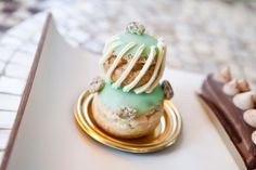 Salted Pistachio Religieuse at Dominique Ansel Bakery French Bakery, French Pastries, Pistachio Cake, Salty Cake, Cake Trends, Pastry And Bakery, Baking Tins, Great Desserts, Dominique Ansel