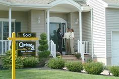 Century 21 Sign with satisfied customers!