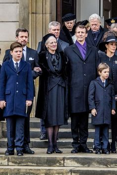 Show of support: Queen Margrethe was flanked by her sons Crown Prince Frederik (to her right) and Joachim (to her left) as they left the service today