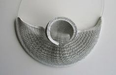 Necklace, recycled paper and steel wire by Janna Savanoja, Finland.
