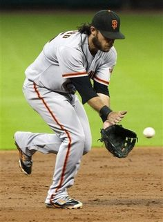 San Francisco Giants shortstop Brandon Crawford (35) fields a ball in the second inning against the Houston Astros during a baseball game, Thursday, Aug. 30, 2012