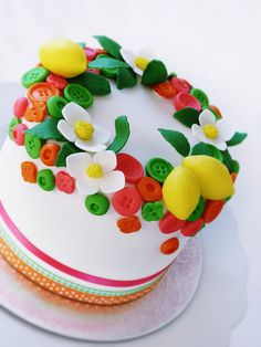 top tier: Bright colors with fruit and buttons and flowers