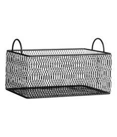 Black. Metal storage basket with handles at upper edges. Size 4 1/2 x 6 1/2 x 9 3/4 in.