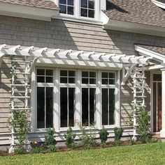 A shallow pergola and trellises give definition to this wall of windows by Marvin. Front Window Design, Window Glass Design, House Window Design, French Casement Windows, Window Replacement, Transom Windows, Sash Windows, Front Doors With Windows, Gardens