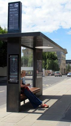 SMART URBAN - Great example of how high a streetcar/ busstop sign could be- and how a simple design is effective/ easy to read and understand. Bus stop, City of Bath - Design PearsonLloyd City Furniture, Urban Furniture, Street Furniture, Concrete Furniture, Furniture Design, Transport Public, Bus Stop Design, Bus Shelters, Shelter Design