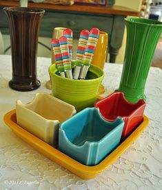 10 different ways to use fiestaware napkin tray.  This would be cute on Kitchen counter with spices ant tools.
