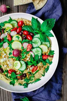 Mediterranean Farmer's Market Hummus Dip | The Mediterranean Dish. Easy, BIG hummus dip! Ready in like 10 minutes! Show-stopping hummus loaded with Mediterranean favorites: Fresh herbs and greens, veggies, feta, olives, sun-dried tomatoes…Get the recipe on TheMediterraneanDish.com