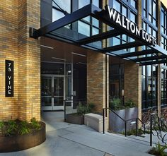Residents of Walton Lofts enjoy a great neighborhood and fabulous amenities in each Belltown Seattle apartment. Store Fronts, Urban Design, Entrance, Brick, Garage Doors, Lofts, Floor Plans, Architecture, Building