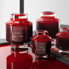 Bring warmth to your home with this Fire scented candle from Tom Dixon. Made from a natural wax blend the scent is inspired by the medieval alchemist and eastern philosopher's quest to reduce all ma Fire Candle, Candle Jars, Candle Holders, Tom Dixon Lighting, Cadeau Design, Toms, Candle Accessories, Bathroom Accessories, Candle Packaging