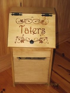 An attractive way to store up to 10+ pounds of potatoes. Decorative front lid lifts for easy access and intricately etched with wood burning tool. Large drawer underneath for additional storage. Constructed out of solid Pine boards. Outside of Potato bin is finished in golden oak stain, while the interior is left natural to prevent tainting of stored goods.