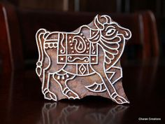 Check out this item in my Etsy shop https://www.etsy.com/listing/123842694/hand-carved-indian-wood-textile-stamp