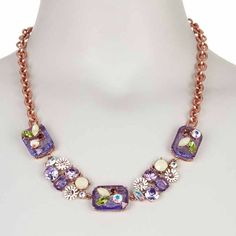 Betsey Johnson Embellished Statement Necklace This stunning necklace is the perfect accessory to compliment your spring wardrobe! Pretty rose gold toned chain. The purple glass stones and beautiful embellishments make this a standout addition to any jewelry collection. No trades. Reasonable offers considered. Betsey Johnson Jewelry Necklaces