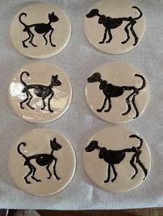 Cat and dog skeleton coasters £20.00