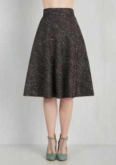 Deciding on this boucle midi skirt is a simple choice that promises stellar results! By embracing the taupe- and tinsel-flecked stripes that weave through the black fabric of this high-waisted delight, you set the stage for a look that appears carefully calculated, but was a cinch to assemble!