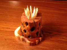Here we have a brand new handmade toothpick holder made from an Arizona Cholla Cactus skeleton. It was hand rubbed with red mahogany stain and