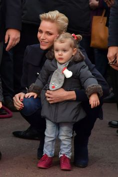 Princess Charlene and her daughter Princess Gabriella of Monaco during the inauguration of the Christmas Village in Monaco on 3 December 2016.