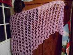 Delicate Pearlized Orchid Original Design Shawl / Wrap crocheted with acrylic yarn that is machine washable on GENTLE and dryed on air only or hanged to dry. I really suggest hand washing but Bernat yarn says you can with care! This is a large wrap almost 70 inches wide by 31 inches long. See more www.KaysKoolKrochet.Etsy.com .